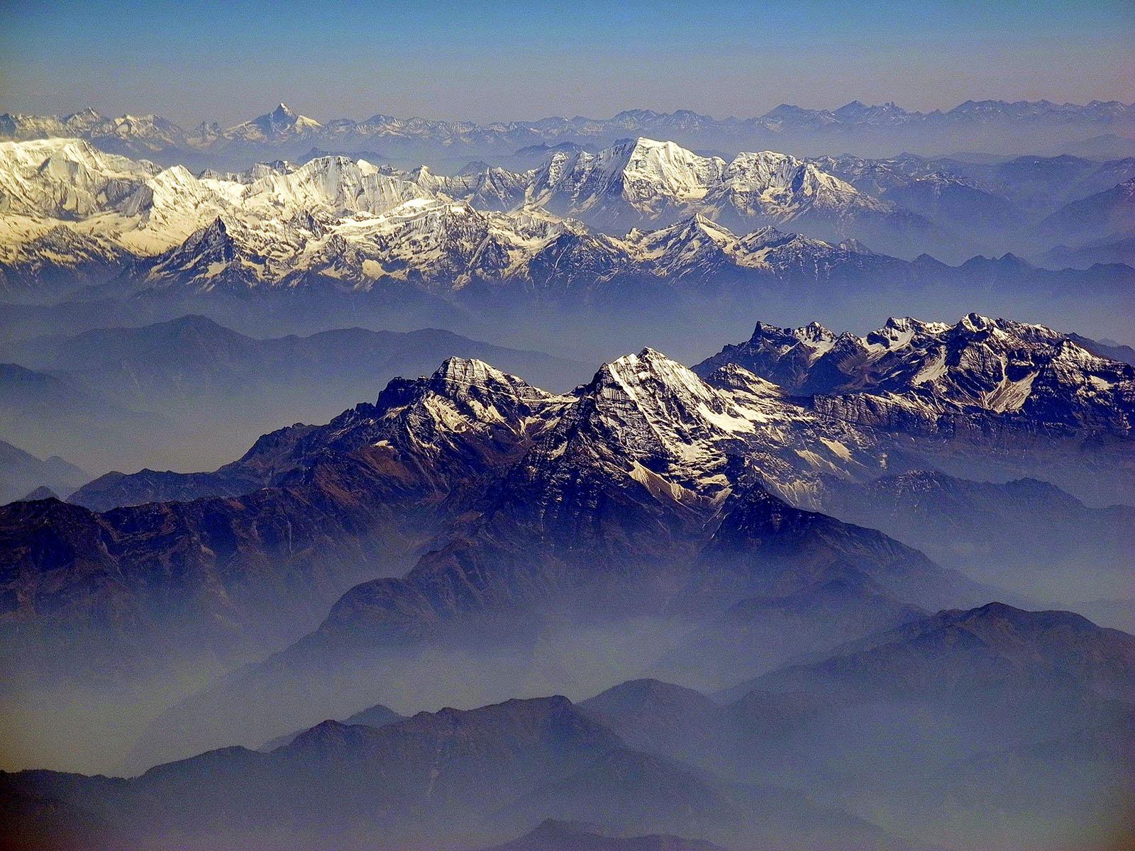 Fine-Tuned India-Asia Collision Cools Earth for Human Habitation